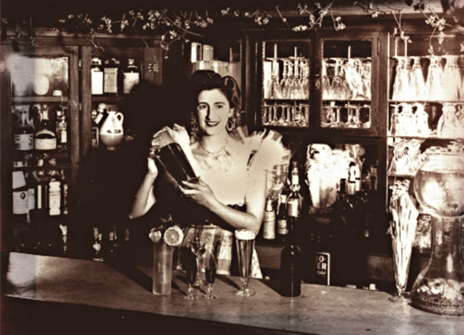 Tess behind the bar